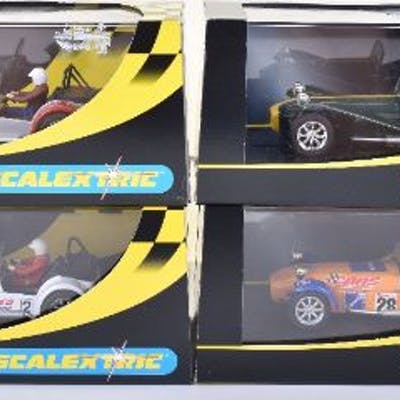 Four Scalextric Caterham 7 Boxed Cars