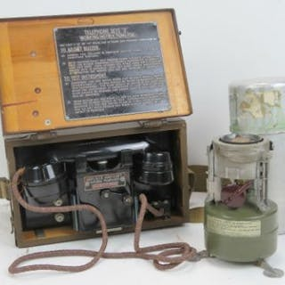 A British WWII field telephone in case together with a field portable