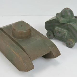 Two vintage handmade wooden toy tanks, one painted in camo with rotating