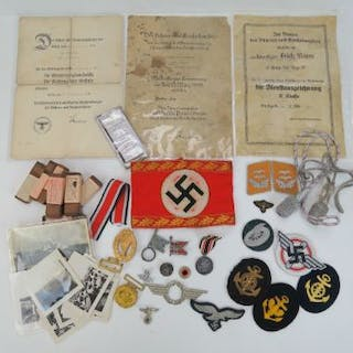 A quantity of German militaria including; awards, medals and paperwork.