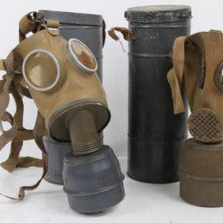 Two WWII Axis Military Issue gas masks, in original carry cans with filters.