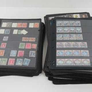A large quantity of stamps in loose leaf binder pages, approximately