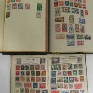 Three vintage stamp albums having assorted, stuck down, world stamps within.
