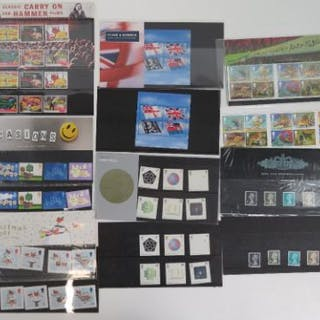 Seven Royal Mail mint presentation pack stamps with matching stamp sets;