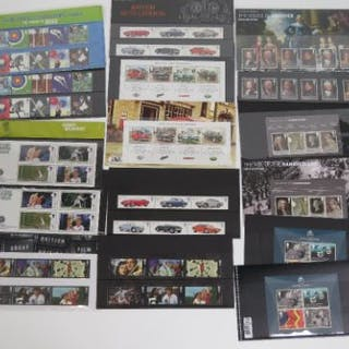 Five Royal Mail mint presentation pack stamps with matching stamp
