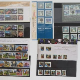 Four Royal Mail mint presentation pack stamps with matching stamp