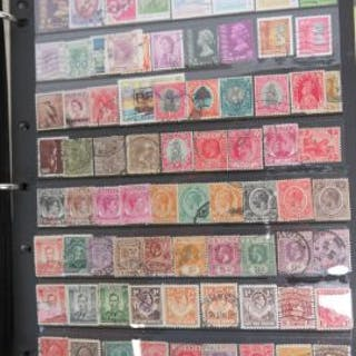A collection of Victoria - Elizabeth II stamps in loose page album including;