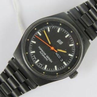 A ladies Porsche design Teflon automatic wristwatch having orange