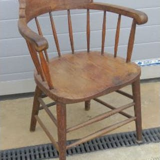 A single oak elbow chair raised over turned legs, one spindle is loose, a/f.