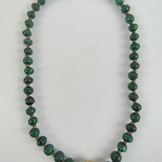 A heavy malachite bead necklace, graduated beads having brass spacers
