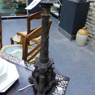 AN ANTIQUE GOTHIC REVIVAL BRONZE TABLE LAMP.