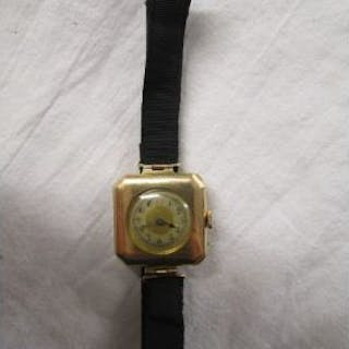 Gold ladies wrist watch on ribbon strap