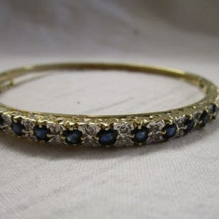 Gold sapphire and diamond bangle
