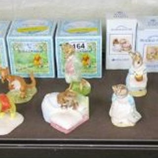Collection of boxed figurines to include Royal Doulton Winnie the