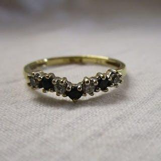 Gold sapphire and stone set wishbone ring
