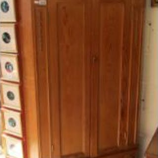 Tall pine corner cabinet with dome top doors