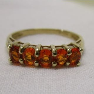 Gold ring set with fiery orange stones