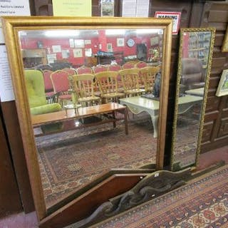 Large gilt framed mirror with another