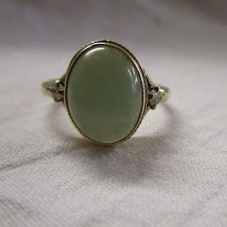 Gold jade and diamond set ring