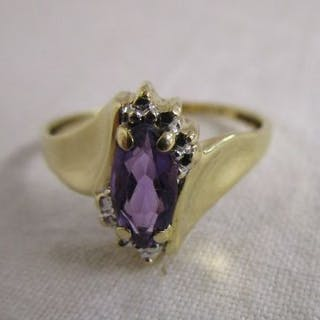 Gold designer amethyst set ring