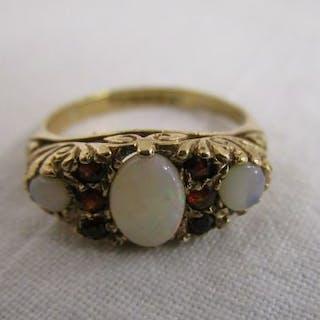 Gold opal & garnet gypsy set ring
