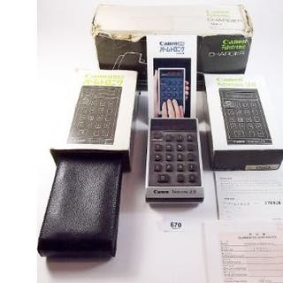 A Canon Leigo palmtronic early calculator and charger - boxed with instructions