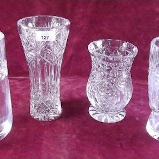 Four heavy cut glass vases