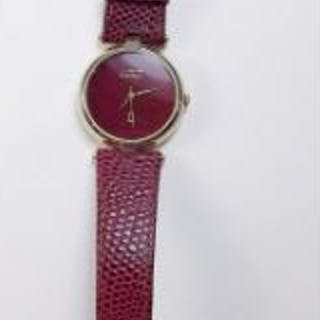 A Must de Cartier red wrist watch