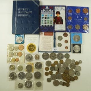 A quantity of pre-decimal coinage including brass threepences and