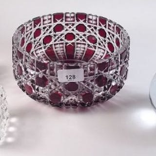 A ruby flashed cut glass fruit bowl, a large paperweight and a pair