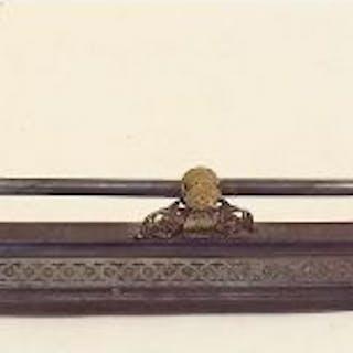 A Victorian cast iron and brass fire surround - 139cm wide x 40cm deep