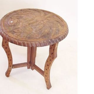 An Eastern occasional table carved tree and elephant