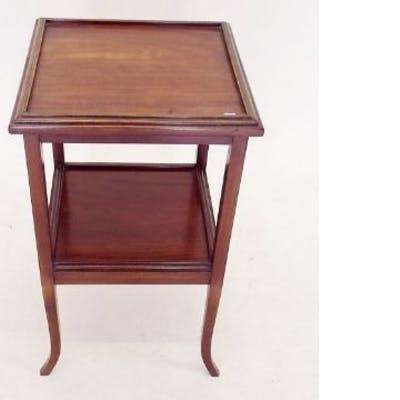 An early 20th century mahogany two tier occasional table
