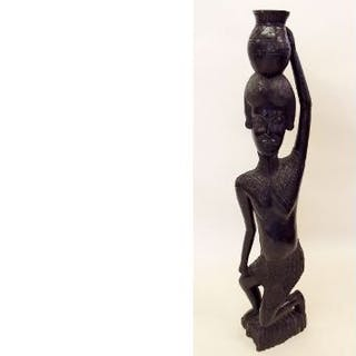 A large early 20th century carved ebony African tribal figure of a