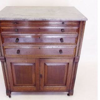 A 19th century continental chest of drawers with marble top