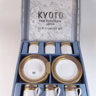 A Kyoto Japanese porcelain coffee set with gilt borders, comprising