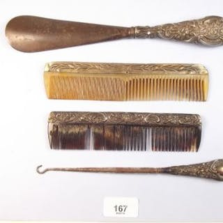 Two silver combs, silver button hook and silver plated shoe horn