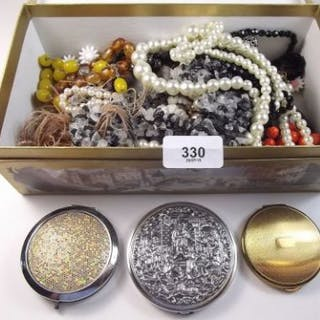 A box of costume jewellery including three compacts