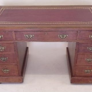 An Edwardian figured mahogany twin pedestal desk