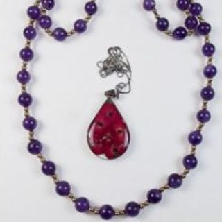 An amethyst and yellow metal bead necklace and a silver and glass pendant