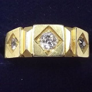 A Victorian 18 carat gold ring set three diamonds in square settings