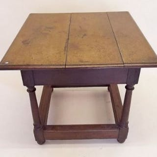 A late 17th/early 18th century oak square topped hall table on turned