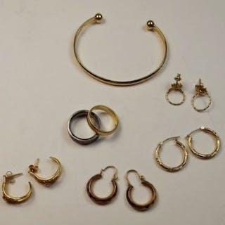 A 9 carat gold bangle, a pair of 14 carat gold earrings, a 9 carat
