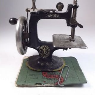 A Singer sewing machine No.28K - with instructions