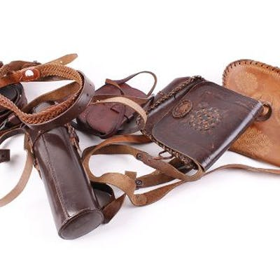 Three various leather cartridge bags; four leather cartridge belts;