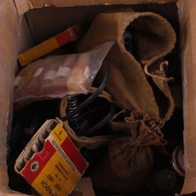 Large box of mixed gun parts incl, cloth bag of springs and scope mounts