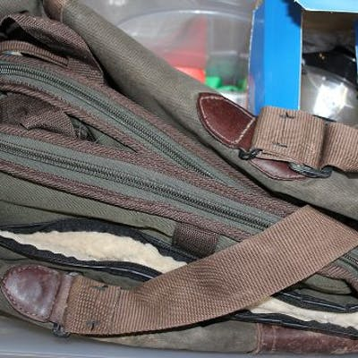 Box of shooting miscellany: torch; ear defenders; slips; waterproof