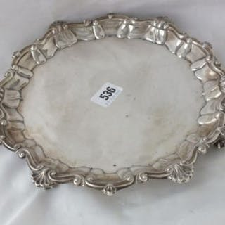 GEORGE II STYLE SALVER with moulded and shell border on four claw