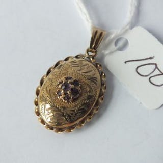 9ct antique oval locket inset with amethyst 2.9g inc
