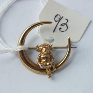 9ct Brooch designed as an imp sitting on a crescent moon.